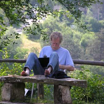 Steve Trenam writing poetry in Tuscany